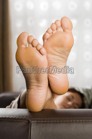 feet of woman on sofa