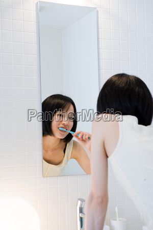 japanese woman brushing her teeth