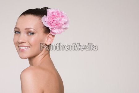 young woman with flower in her