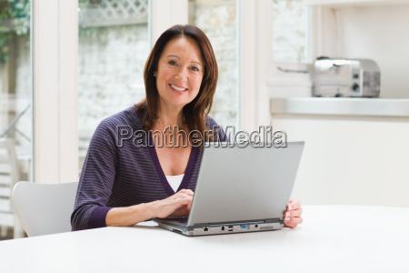 mature woman using a laptop