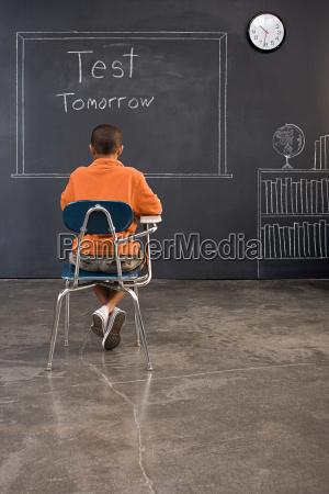 rear view of a boy sat