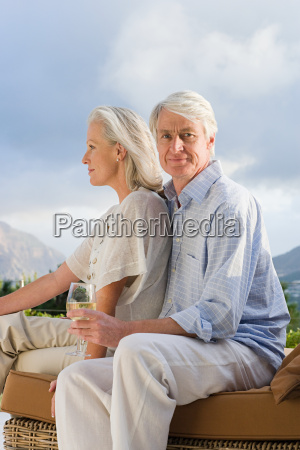 middle aged couple relaxing outside with