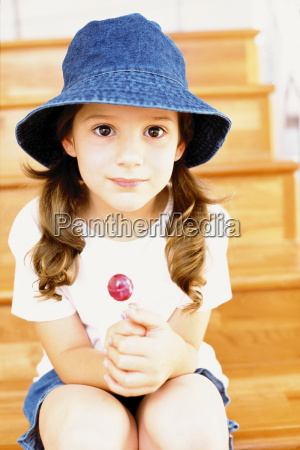 girl wearing a bucket hat