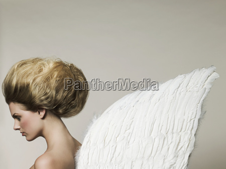 young woman wearing angel wings