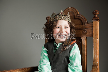 young boy wearing gold crown