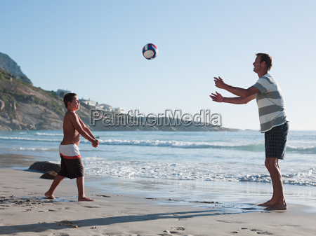 father and son playing ball on