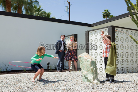 family playing outside home