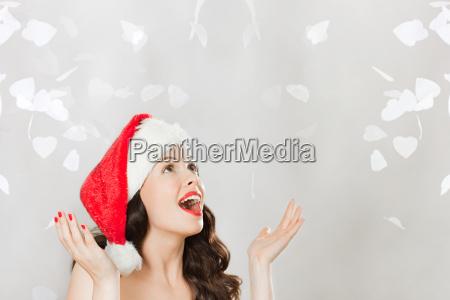 young brunette woman wearing santa hat