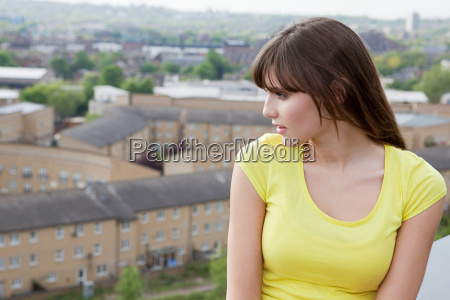 young woman and urban scene in