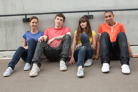 young people sitting in row