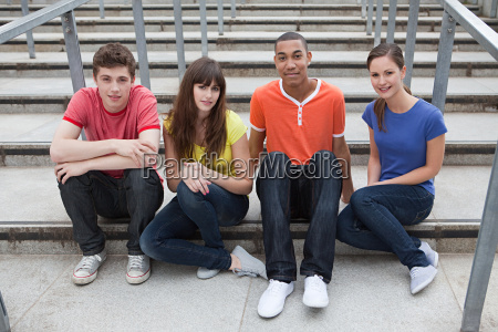 young people sitting on steps