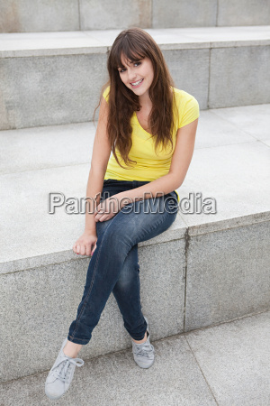 young woman sitting on step