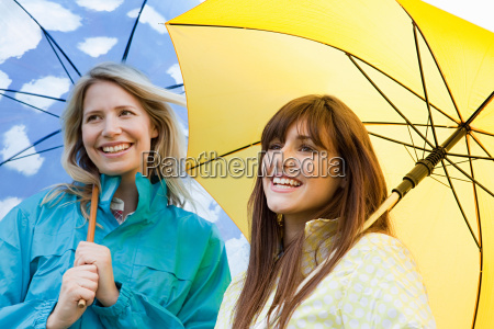 two young women with umbrellas