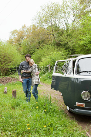 young couple by camper van