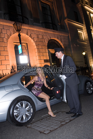 wealthy woman getting out of car