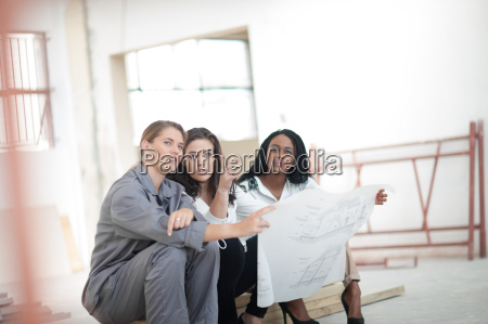 designers working with construction worker on