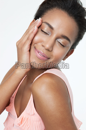 happy young woman touching face
