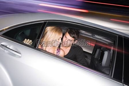 young, couple, in, a, speeding, car - 18651312