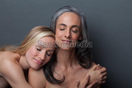 young woman and mature woman hugging