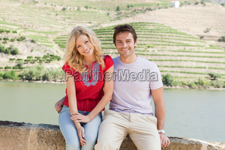 couple sitting by douro river
