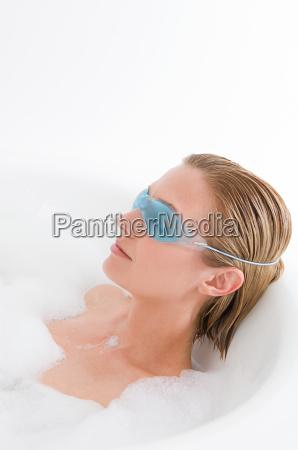 a woman wearing an eye mask
