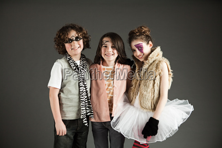 three young friends dressed up