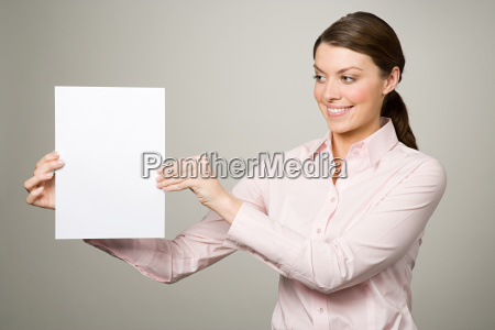 a woman holding a piece of