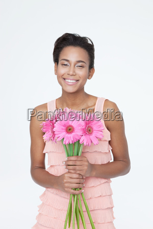 beautiful young woman with pink flowers
