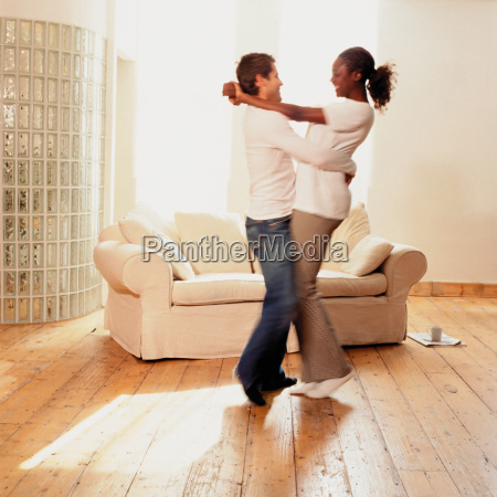 couple dancing at home