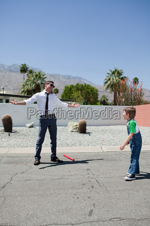 father and son playing outside