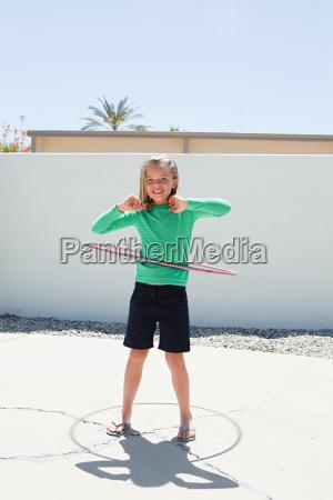 young girl with hoola hoop