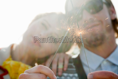 young couple with sparklers