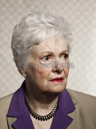 studio portrait of worried senior woman