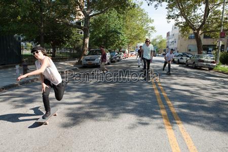 skateboarders on urban street