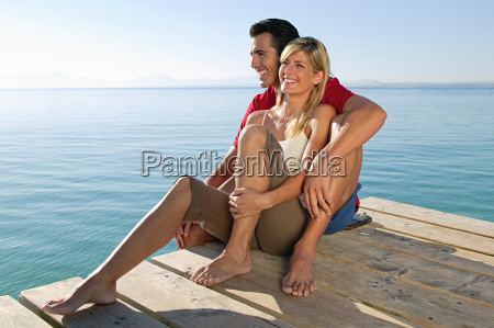 happy couple on a jetty by