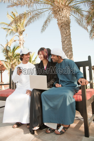middle eastern people with laptop and