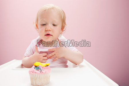 baby girl with cupcake