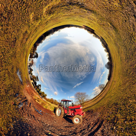 tractor in field with tunnel effect