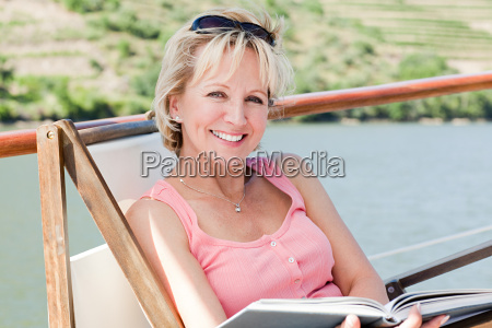 mature reading book woman on a