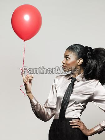 businesswoman holding balloon