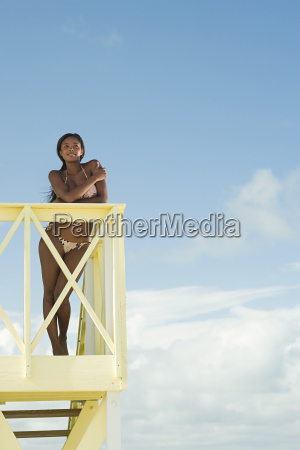 young woman at beach house