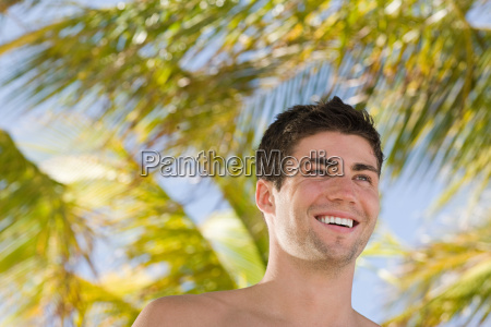young man and palm trees