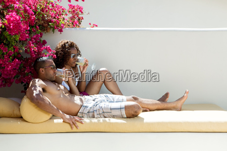 couple drinking wine and relaxing on