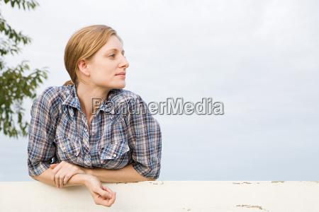mid adut woman in paddock looking