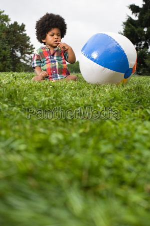 baby boy looking at beach ball
