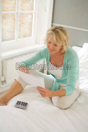woman with paper and calculator