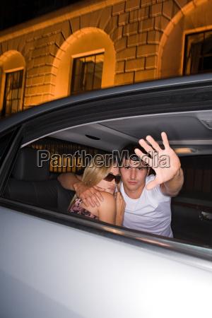 secretive couple in a car