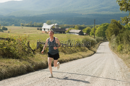 mature adult man running on rural