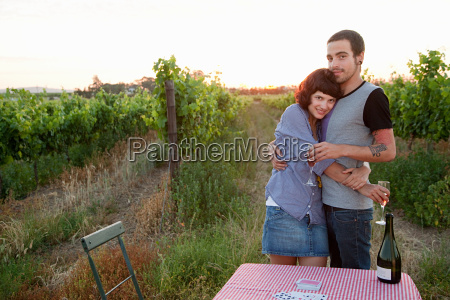 couple in a field with table