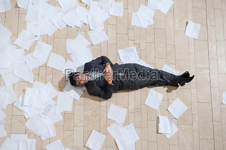 businessman, lying, on, floor, with, scattered - 18669732